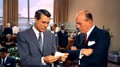 """ROGER: """"Do you know this man?"""". Cary Grant and Philip Ober in """"NORTH BY NORTHWEST"""" (1959)."""