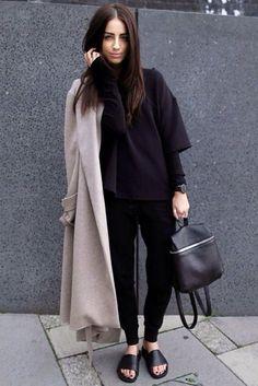 tan coat, all black everything else