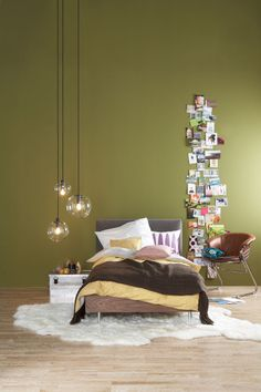 clever use of wall space; creating height with vertical collage (and lights, but more importantly the photos)