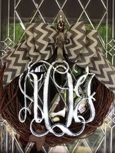 """These are 18"""" grapevine wreaths with 3 letter monograms that I paint to look """"distressed"""".  Chevron Burlap bow is added.  These are $55."""