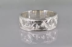 This is me executing my passion of hand engraving on a sterling silver band. This is a heavy weight ring that is 6mm wide and in a size 7.