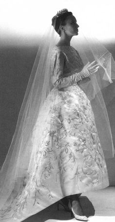 1957 Cristobal Balenciaga wedding dress. Ivory shantung with ornate embroidery in gold metallic thread twisted around a silk core, and faux pearl sequins in floral motifs.