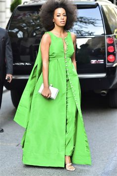 Attending a charity benefit in New York City in May 2015, Solange Knowles picked a vibrant daytime ensemble by Rosie Assoulin. The bright green gown featured button detailing down the front, and Solange wore the dress with a pair of matching green pants underneath. RELATED: Fashion face-off: Beyonce v. Solange