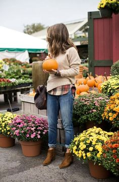 Love this fall look! Cute sweater over a plaid shirt. The boyfriend Jean and boot matches perfectly.