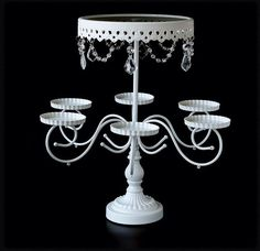 Candelabra White Metal Round Cake Stand When it comes to catering an exclusive event or once in a lifetime celebration presentation is everything