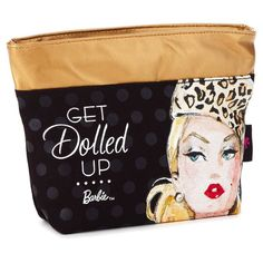 Keep cosmetics close at hand and get dolled up wherever you are. Chic makeup bag lined with pink fabric features a faux-leather metallic gold top and zipper pull, which highlights subtle black polka dots on black background with fabulous Barbie™ image and lettering. Reverse features complementing pattern of subtle black polka dots, Barbie™ silhouette and signature letter B.