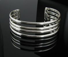 .925 Sterling Silver 4 Row Polished Cuff Bracelet from Abrams Jewelry
