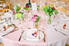 pretty pink (polka dot!) tabletop with casual small flower arrangements, photo by shelldemar.com