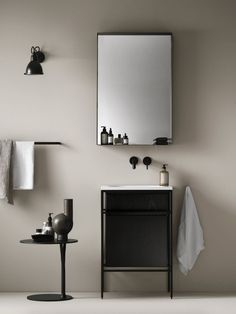 Minimal bathroom with black taps by Lagomhome