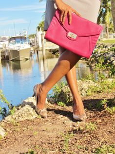 Pink clutch and python pumps