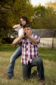 Couple with guns drawn picture. Cool engagement picture. Photographed by Gloria Webster