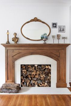 Fill a non-working fireplace with cut logs = a great idea!