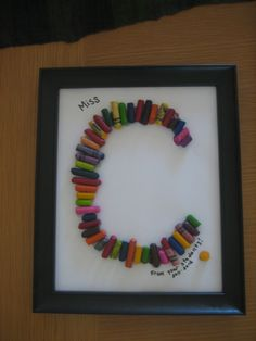 Found this idea in a magazine. Collect broken crayons from students in your child's class, then hot-glue them down in the shape of the initial of the teacher's last name! Put in an inexpensive frame, remove the glass, and add a personal note with a Sharpie. Voila! A cute end-of-year or staff appreciation gift from the whole class.