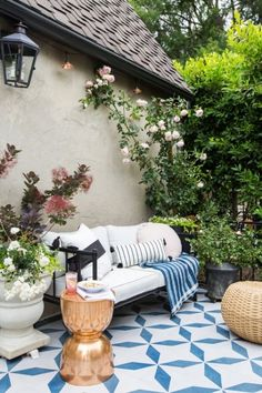 Emily Henderson's created multiple seating areas on her tiny patio by adding only functional pieces.