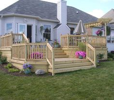 wood deck for the backyard; multi-level gives it a great effect. Great area to entertain.