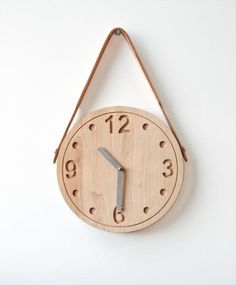 RAW Clock is made of solid maple wood. The clock celebrates the natural beauty of wood - raw and left untreated. The design is of an archetypal clock face, fabricated using a CNC milling machine. $185