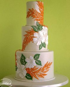 Tiered Aloha Cake Featuring Hawaiian Flowers, not crazy about the color scheme but its an idea for a pretty tropical cake, Hawaiian design.