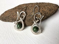 A personal favorite from my Etsy shop https://www.etsy.com/listing/279515456/silver-wire-wrapped-woodsprite-earrings