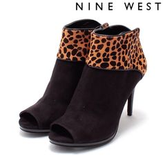 Nine West Suede Cheetah Print Peeptoe Booties New and unworn! These beautiful Peeptoe booties are made of black suede. The back and upper portion are composed of dyed cow hair made to look like cheetah print. Very soft! There is a small platform (about 1/4 inch) to help with the 3.5 inch stiletto heel. Absolutely gorgeous! Size 5.5, box not included. Nine West Shoes Ankle Boots & Booties