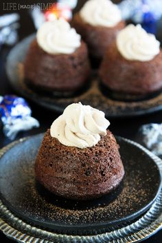 Easy Molten Chocolate Cupcakes in a muffin tin. The center is your choice of flavor of Lindt Lindor Truffles.
