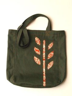 reverse applique book tote tutorial. LOVE this. hope to try. http://www.flamingotoes.com/2011/08/paisley-leaves-book-tote/
