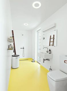 VOLA Taps for bathroom In the bathroom of this tiny floating home in Denmark, the epoxy floor transitions from whitish gray to submarine yellow. The black-and-white industrial laundry bin is by Vipp. Modern bathroom with yellow floors Terrazzo Flooring, Bathroom Flooring, Epoxy Resin Flooring, Linoleum Flooring, Rubber Flooring, Bathroom Cabinets, Bad Inspiration, Bathroom Inspiration, Epoxy Floor Designs