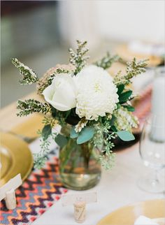 mason jar white floral centerpiece #centerpiece #masonjarcenterpiece #weddingchicks http://www.weddingchicks.com/2014/04/14/vintage-eclectic-california-wedding/