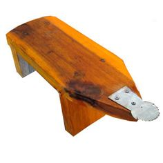"""Buy this little wooden """"rabbit"""" to grate coconut for homemade coconut milk in the traditional Thai way. $22.99 TempleofThai.com"""
