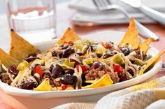 Like your nachos with the works? This recipe will work for you! It's got it all: ground beef, taco seasonings, yummy melted cheese and chopped tomatoes.