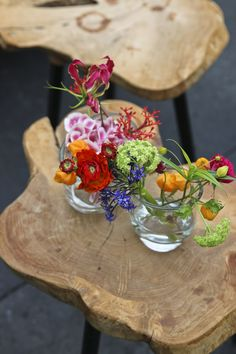 Wild flowers in small glasses - instant color - natural look - wooden side table