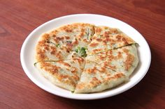 Recently, I was overcome by my desire to master cooking the food I love from my home country of Taiwan. So I decided to make scallion pancakes. These bear almost…
