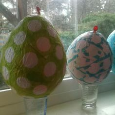 Paper mâché Easter eggs Balloon + punched tissue paper + glue, pop and pull out balloon when dry, fill with treats!