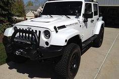 White Jeep Wrangler Rubicon Unlimited 2014 with AEV Lift Kit, AEV Bullbar and AEV Head Reduction Bonnet.