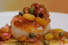 Sea Scallops/tomato-truffle butter/savory rice pudding. From Where to Eat in Monterey, California