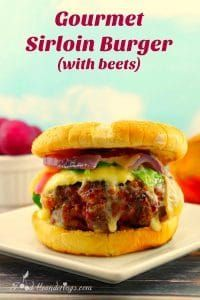 Gourmet Sirloin Burger (with beets) recipe- foodmeanderings.com Wild West goes Uptown! This award-winning gourmet sirloin burger is made with beets, cranberry orange aoili, peanut butter BBQ sauce, creamy brie cheese, roasted apples and onions on grilled