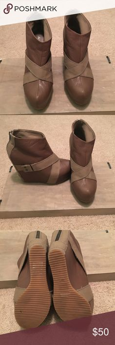 Boots Dartanian wedge booties with a 4 inch Heel only worn two times   Looks good with jeans. Zippers in the back and still in really good condition Aldo Shoes Ankle Boots & Booties