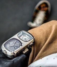 On the wrist is the full-100,000CHF Angelus U10 Tourbillon.