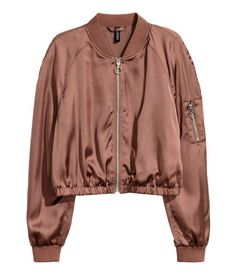 Bronze-colored. Short satin bomber jacket with a zip at front. Ribbed collar, sleeve pocket with zip, ribbed cuffs, and elasticized hem. Lined.