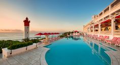 Seaside restaurants in Durban, South Africa. The Ocean Terrace at the Oyster Box Hotel overlooks the landmark lighthouse and Indian Ocean.