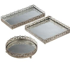 Set of three mirrored vanity trays with filigree rims. Product: Circular, rectangular and square tray Construction Material: Metal and mirrored glass Color: Champagne Features: Elegant filigree trimVersatile design Dimensions: H x W x D (rectangular tray) Diy Wedding Supplies, Wedding Supplies Wholesale, Wedding Ideas, Mirror Vanity Tray, Mirrored Vanity, Antique Vanity, Vintage Vanity, Mirror Mirror, Square Tray