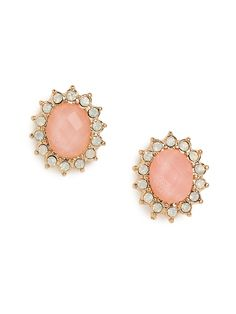 These charming stud earrings work a delightfully feminine allure. Its crafted from a beautifully faceted pink gem, framed by glittering teardrop-shaped crystals.