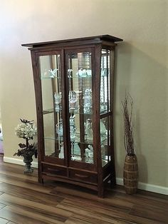Led Lighted Walnut Curio Cabinet With Ebony Square Pegs In Drawers, Mirror  Back And Bottom, Beveled Edge Tempered Glass, And Three Adjustable Shelves.