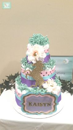 I created this 3-Tiered Unicorn Diaper Cake for a themed baby shower with pink, mint green, purple and gold as the colors of choice.