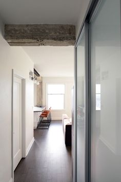 San Francisco Condo conversion- functional small spaces with minimalist design. & Urban loft combines modern form and function. Opaque doors allow ...