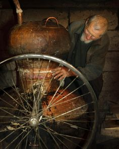 Old man distilling brandy
