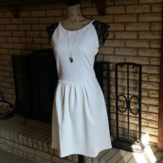White Lace Back Dress Classy slightly cream colored knee length dress with sheer black lace button up back. Black cap sleeves. Size M. Looks more like a Small. So sexy and pretty!  Brand new. Has stretch. Poof! Dresses Midi