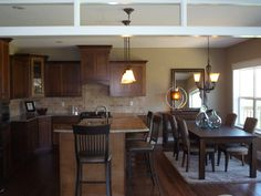Model Home from 2010 that I did with strand bamboo flooring, travertine backsplash, Amisco barstools and dining room from Turning House
