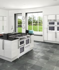 """Belling launches a collection of ver smart white range cookers, freestanding cookers and built-in ovens. All part of the centenary celebrations called """"The 100 Collection"""" marking 100 years of Belling appliances."""