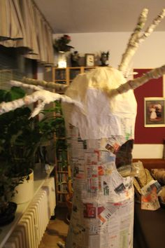 After you put paper mache all over body of tree its time to start with the branches.. its your choice what you use.. I took spray foam and sprayed it all over the top. When its dry you can make holes in it for the wooden dowels. I used a hot glue gun to attach the dowels into the holes. after they were dry I started to add the little branches.. you can make them in any direction you want..