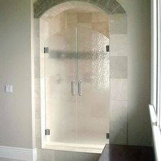 Avoid shower doors bathroom pinterest shower doors doors and bath this opening features rain glass double doors with a custom arched top to match the opening delta glass houston tx serves league city pearland planetlyrics Gallery